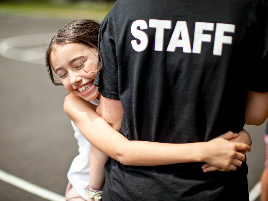 girl-hugging-staff